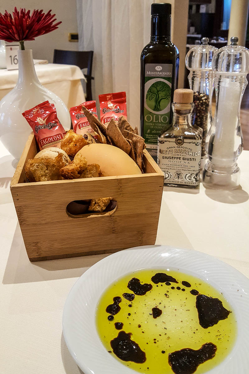 A bread basket with a plate with olive oil and balsamic vinegar - Restaurante Mezzaluna - Hotel Viest, Vicenza, Italy - www.italybyus.com